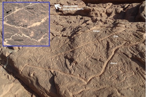 Figure 4 Engravings on the sandstone rock of Aozu (photo by the author). Inset: Satellite imagery of the greater Aozu area. Source: Google maps, modified by the author.
